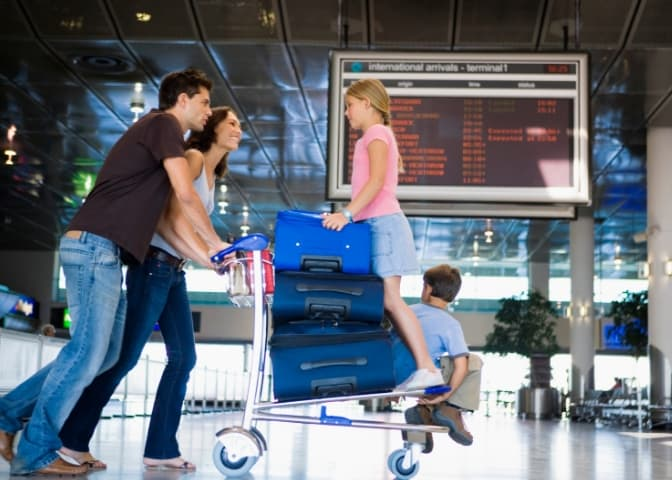 Parents with children at the airport