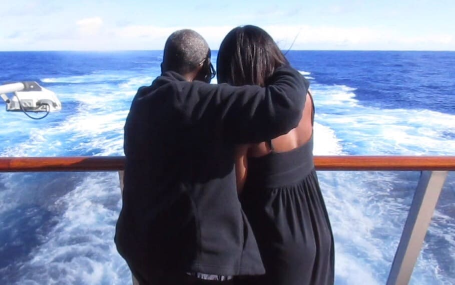 My mom and I looking out to the ocean while hugging
