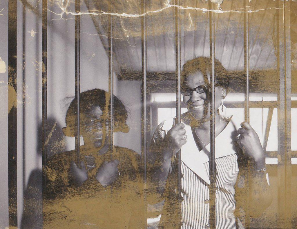 2 women shown behind bars